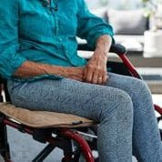 lady in wheelchair with Chair protector